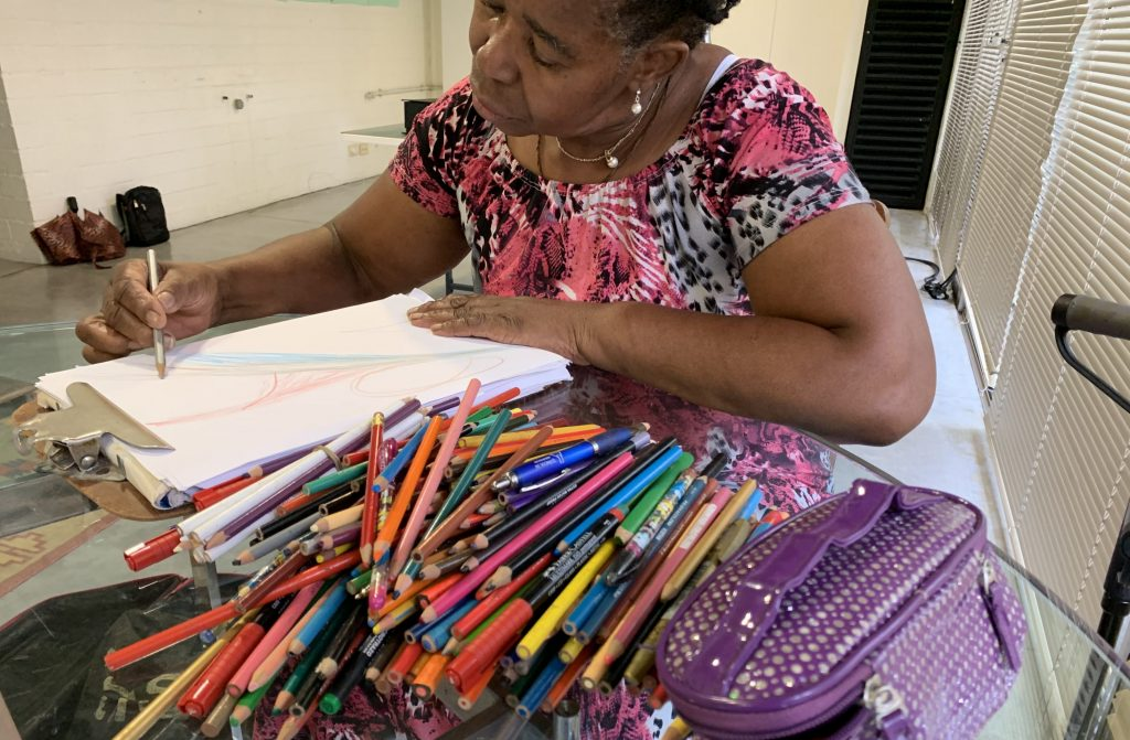 Albita Guerrera doing a healing drawing.